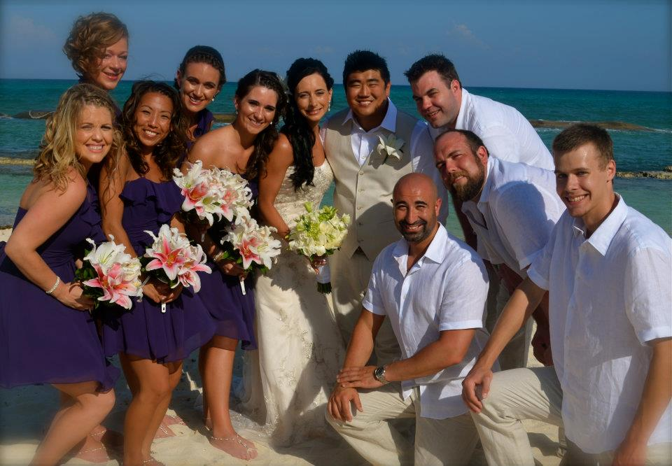 destination wedding group on beach