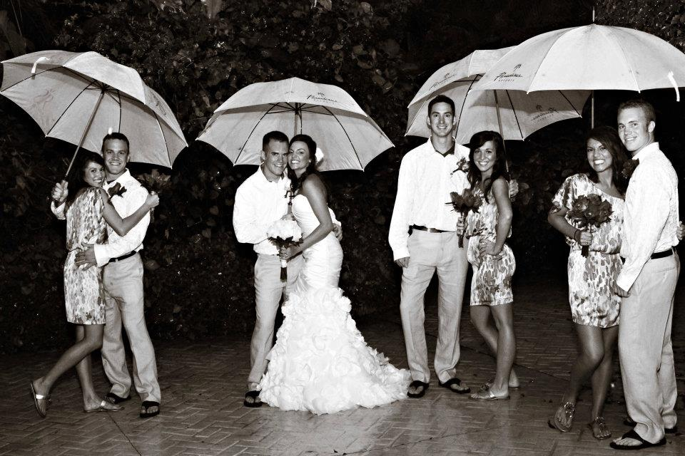 destination wedding group with umbrellas copy