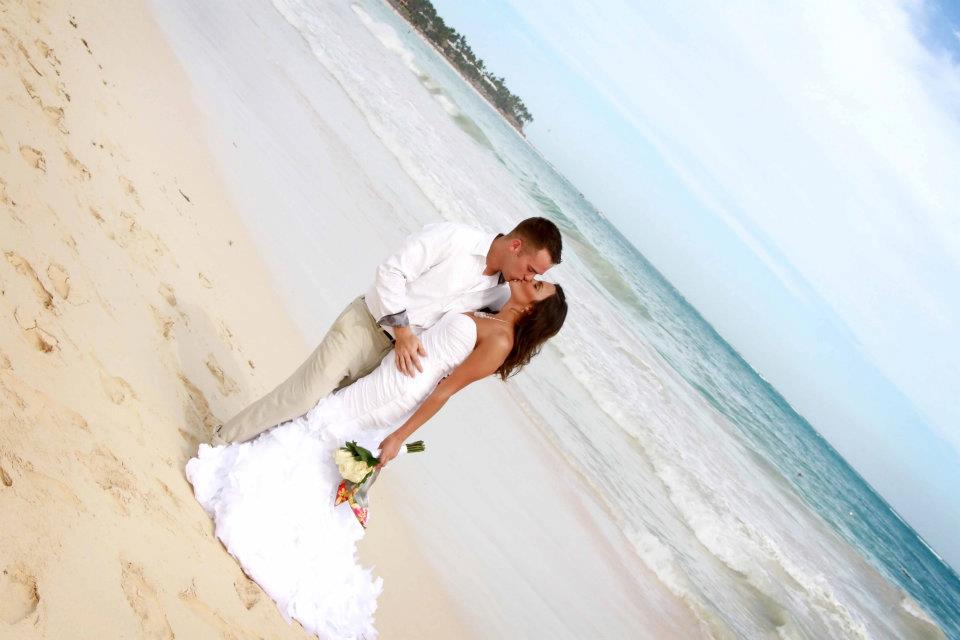 kissing on beach at destination wedding copy