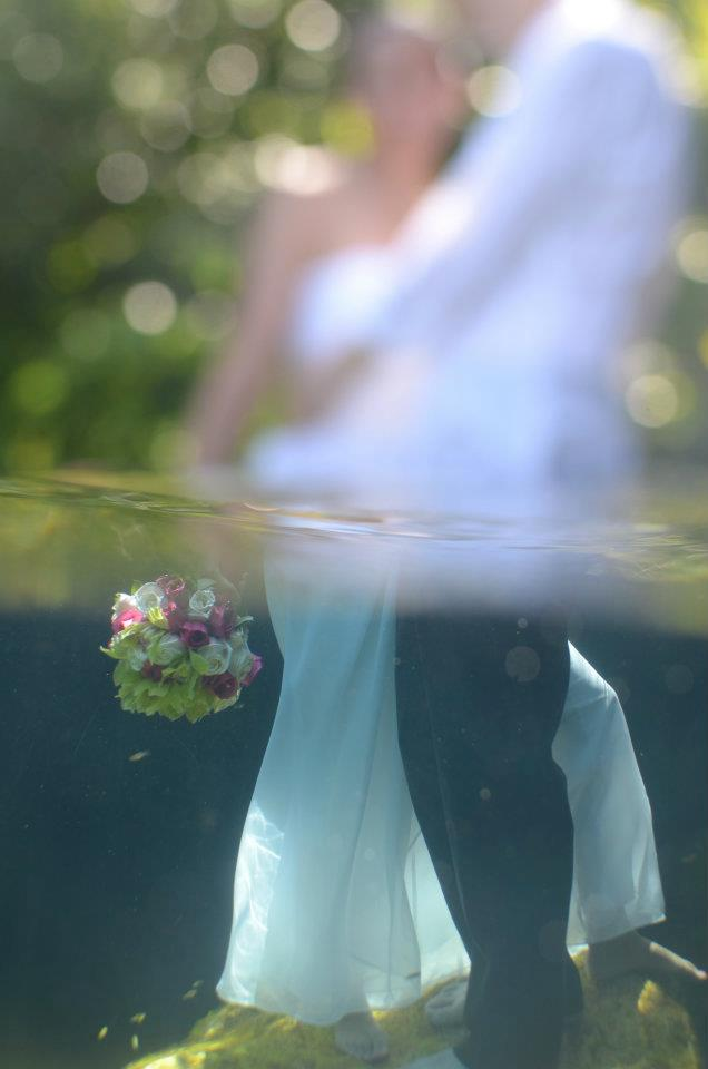 sweet destination wedding and trash the dress pic with bouquet in water copy